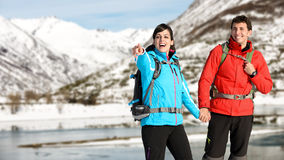 Winter hiking couple Royalty Free Stock Image