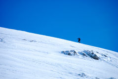 Winter hiking. Man climbing a mountain in winter Stock Photos