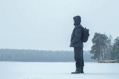Winter hiking man looking at frosty forest amazing landscape Royalty Free Stock Photography