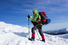 Winter hiking in the mountains . Stock Photo