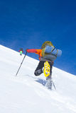 Winter hiking in the mountains on snowshoes with a backpack and tent. Stock Photography