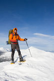 Winter hiking in the mountains on snowshoes with a backpack and tent. Stock Images