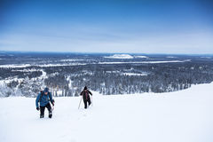 Winter hiking on snow covered mountain Stock Photos