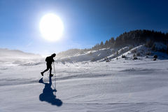 Winter hiking on snow. Silhouette of the man walking on snow.Enjoyable nature stock photo