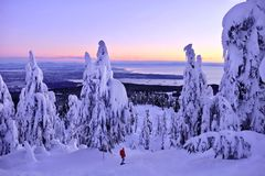 Winter hiking snowshoeing in snowy mountains at sunset. Stock Image