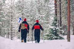 Winter hiking. Tourists are hiking in the snow-covered forest. Beautiful winter landscape royalty free stock photo