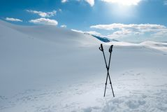 Winter hiking, two trekking poles sticked to the snow Royalty Free Stock Photography