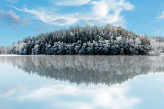 Winter hill reflected in water Stock Photography