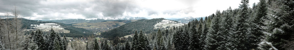 Winter hills and forest landscape. - panorama Stock Photo