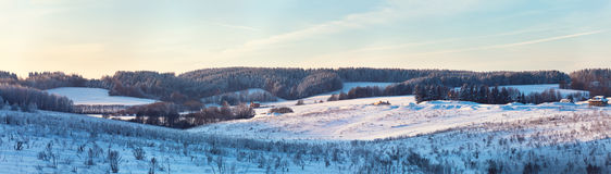 Winter hills. Frozen meadow. Frost on trees Royalty Free Stock Photography