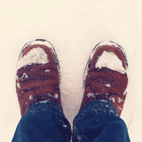Winter hipster boots in the snow Royalty Free Stock Photography