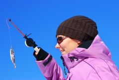Winter hobby. Young attractive girl on winter fishing Royalty Free Stock Photos