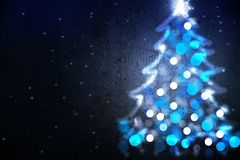 Winter holiday background with blue Christmas tree shape from lights. Winter holiday background with blue Christmas tree silhouette from lights stock image