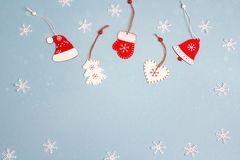 Winter holiday background with red decorations on blue. Space fo Stock Images