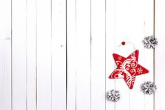 Winter holiday background with red star and snow painted pine co Royalty Free Stock Photography