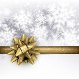 Winter holiday background with golden bow. Royalty Free Stock Image