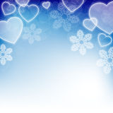 Winter holiday background with snowflakes and heart shapes Royalty Free Stock Photo