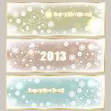 Winter Holiday Banners. With greetings, shiny stars, and snowflakes stock illustration