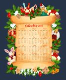 Winter holiday 2018 calendar vector template. 2018 calendar template design of Christmas tree decorations or New Year garland and Santa toy gifts frame. Vector Stock Image