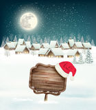 Winter holiday christmas background with a village Royalty Free Stock Photos