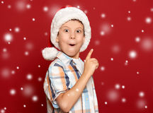 Winter holiday christmas concept - boy in santa hat have idea on Royalty Free Stock Photography