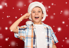 Winter holiday christmas concept - boy in santa hat have idea on Royalty Free Stock Photo