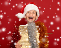Winter holiday christmas concept - boy in santa hat having fun o Stock Photo