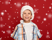 Winter holiday christmas concept - boy in santa hat portrait on Royalty Free Stock Photography