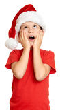 Winter holiday christmas concept - boy in santa hat portrait on white isolated Stock Image