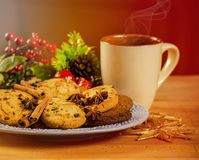 Mug with hot drink and Christmas cookies. Background with cup of chocolate, tea or coffee, festive decoration. Royalty Free Stock Image
