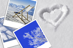 Winter holiday concept, heart, snow and photographs Royalty Free Stock Image