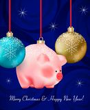 Winter holiday decor. Set of Christmas blue and golden Baubles and cute baby pig a chinese new year symbol hanging on vector illustration