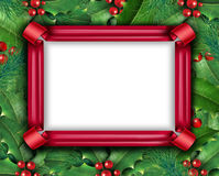 Winter Holiday Frame. With a red ribbon and Christmas holly with with red berries and green leaves with evergreen pine needles on a blank white background for Stock Images