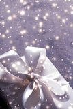 Winter holiday gift and glowing snow background, Christmas presents surprise. New Years Eve celebration, wrapped luxury box and Valentines Day card concept royalty free stock images