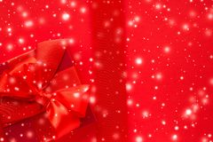 Winter holiday gifts and glowing snow on red background, Christmas presents surprise. New Years Eve celebration, wrapped luxury boxes and Valentines Day card stock photo