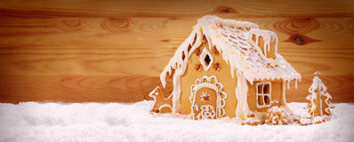 Winter Holiday Gingerbread house . Winter Holiday Gingerbread house isolated on wooden background Royalty Free Stock Photo
