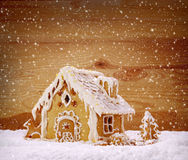 Winter Holiday Gingerbread house . Winter Holiday Gingerbread house isolated on wooden background Royalty Free Stock Images