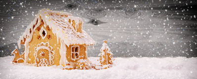 Winter Holiday Gingerbread house . Winter Holiday Gingerbread house isolated on wooden background Stock Photos
