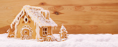 Winter Holiday Gingerbread house . Winter Holiday Gingerbread house isolated on wooden background Royalty Free Stock Image