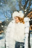 Winter holiday. Happy winter woman in white snow portrait.  royalty free stock image