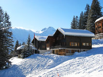 Winter holiday house. In swiss alps Stock Images