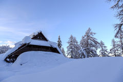 Winter holiday house. In slovenia alps Stock Image