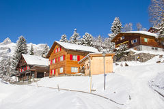 Winter holiday house. In swiss alps Stock Image