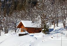 Winter holiday house. In swiss alps Royalty Free Stock Photos