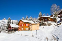 Winter holiday house. In swiss alps Stock Photo