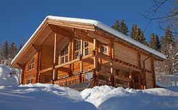 Winter holiday house. In swiss alps Royalty Free Stock Image