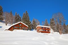Winter holiday house. In swiss alps Stock Photos