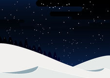 Winter holiday landscape with beautiful snowfall in the night sky. Royalty Free Stock Image