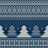 Winter Holiday Seamless Knitted Pattern with Christmas Trees. Seamless Pattern on the Wool Knitted Texture. EPS available Stock Image
