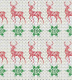 Winter Holiday Seamless Knitting Pattern with deer and Snowflakes. Winter  Seamless Knitting Pattern with deer and Snowflakes Royalty Free Stock Images